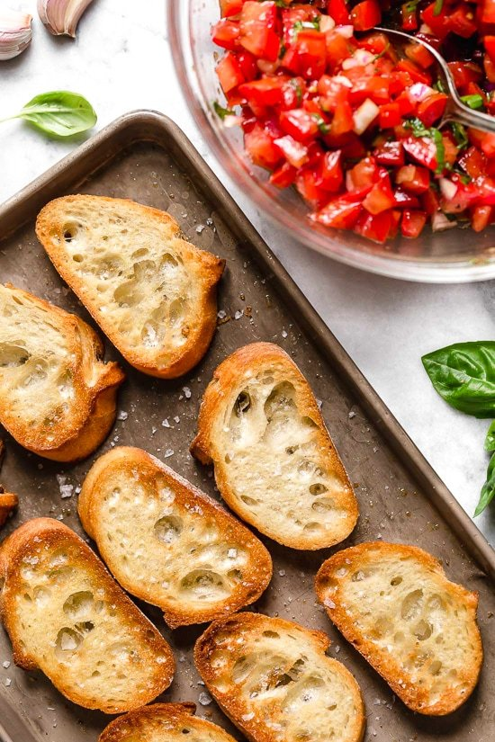 Bruschetta with Tomato and Basil, one of my favorite way to use up my summer tomatoes is with this simple appetizer or side dish.
