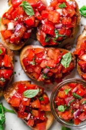 Bruschetta with Tomato and Basil, one of my favorite ways to use up all my summer tomatoes is with this simple appetizer or side dish.