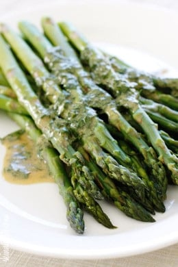 A simple asparagus side dish that really celebrates Spring. Serve it cold or room temperature, leftovers are wonderful chopped and mixed into a salad.