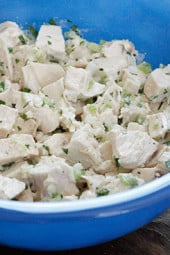Classic chicken salad, made from scratch using less mayo that most recipes call for. Perfect for lunch over salad or in a wrap.