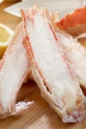 Alaskan King Crab legs on cutting board