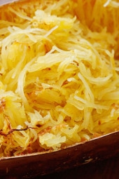 Spaghetti squash is so versatile and easy to make! Enjoy it with salt and pepper as a side dish, drizzle it with butter and grated cheese, or top it with tomato sauce to replace your favorite spaghetti dish. Here is a basic recipe for roasted spaghetti squash.