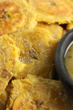 "These Baked Tostones or twice ""Fried"" Plantains aren't fried at all, they are baked in the oven which makes them a delicious, healthy side dish or appetizer!"