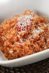Combining cooked quinoa and some leftover homemade sauce like filetto di pomodoro you can make a quick, easy quinoa risotto in minutes.