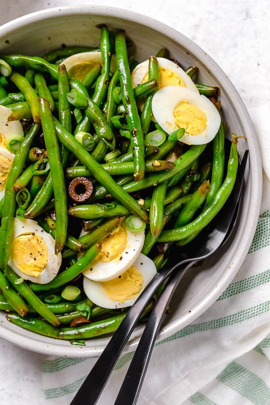 One of my favorite ways to enjoy green beans–in a chilled green bean salad recipe! The delicious flavors of these balsamic green beans made with black olives, scallions and eggs complement any meal or holiday potluck.