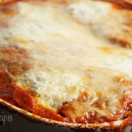This is one of my favorite ways to eat eggplant. Traditionally eggplant parmesan is breaded and fried before baking. I made this lighter by roasting the eggplant in the oven instead, using reduced fat mozzarella and fat free ricotta which reduces the fat and calories significantly. Always use a good parmesan or romano cheese like Locatelli or Reggiano any time a recipe calls for grated cheese for the best results.