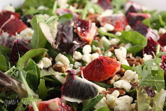 Mixed greens topped with crumbled gorgonzola cheese, chunks of blood orange and chopped pecans