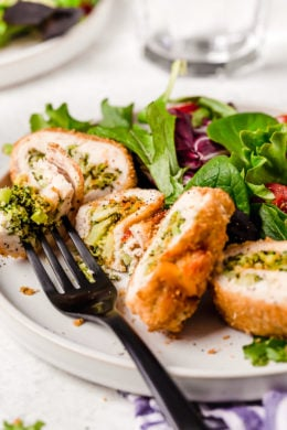 Broccoli and Cheese Stuffed Chicken is filled with cheddar and broccoli, then rolled up, breaded and baked in the oven or air fryer!