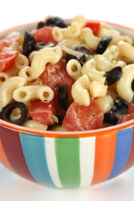 My favorite way to make macaroni salad, a must at every BBQ and perfect for Memorial Day. To lighten this I used light mayonnaise, lots of tomatoes, olives and high fiber pasta.
