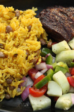 I've gotten requests to add more latin recipes to my site which for me is never a problem since I LOVE latin food! Arroz Con Gandules (Rice with Pigeon Peas) is a Puerto Rican dish popular in the Carribean. The pigeon peas are loaded with fiber which makes this a healthy side if cooked right.