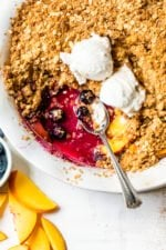Blueberry Peach Crisp with a spoon