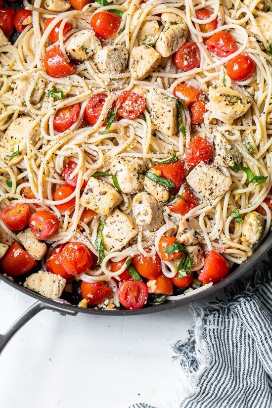 Spaghetti with Sauteed Chicken and Grape Tomatoes in a skillet