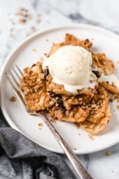 This easy, Cinnamon Apple Crisp is perfect for fall, lightly sweetened with raisins and honey with a crisp, oat topping.
