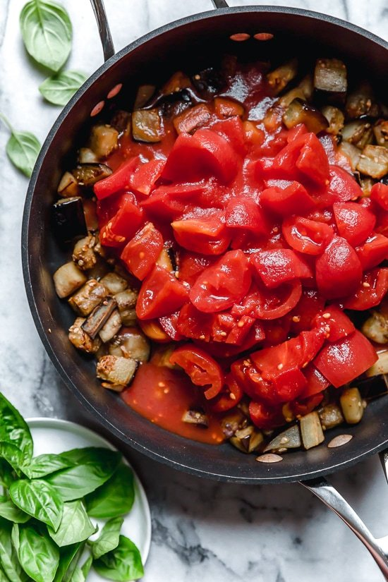 This simple Eggplant and Tomato Sauce is delicious, made with diced eggplant stewed in tomatoes and garlic. I love it served over pasta but it's also great as a side dish on it's own.