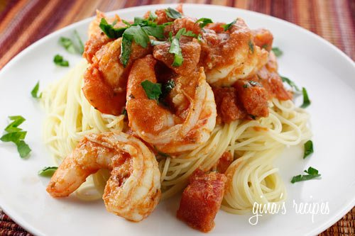 Plate of angelhair pasta with shrimp and tomato sauce