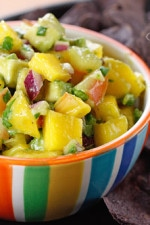 This avocado and mango salsa is a light and colorful party dish with chips. The combination of flavors, sweet and salty with tangy hint of lime makes this a winner. This is also great over grilled fish or chicken!