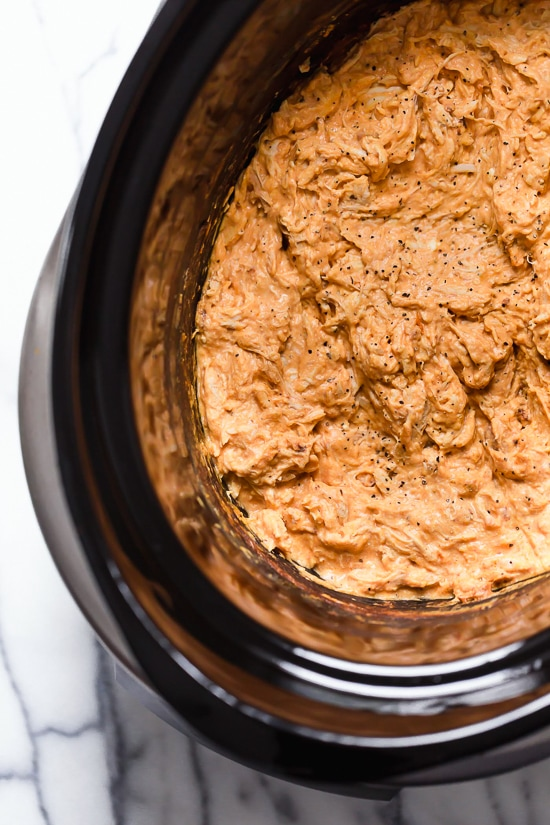 This Slow Cooker Buffalo Chicken Dip has everything you love about buffalo wings, only made into a dip – no messy hands!