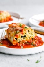 These EASY Spinach Lasagna Roll ups are totally delicious, perfect for entertaining or serving for weeknight meals. Individual vegetarian lasagnas filled with spinach and cheese are family-friendly, satisfying and perfect for portion control. It's also a great way to get your kids to eat spinach and no one will miss the meat!