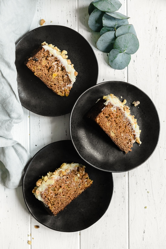 This super moist carrot cake recipe made from scratch is perfect for Easter or anytime of the year. Made with a can of crushed pineapple which makes it very moist, without adding a ton of fat.