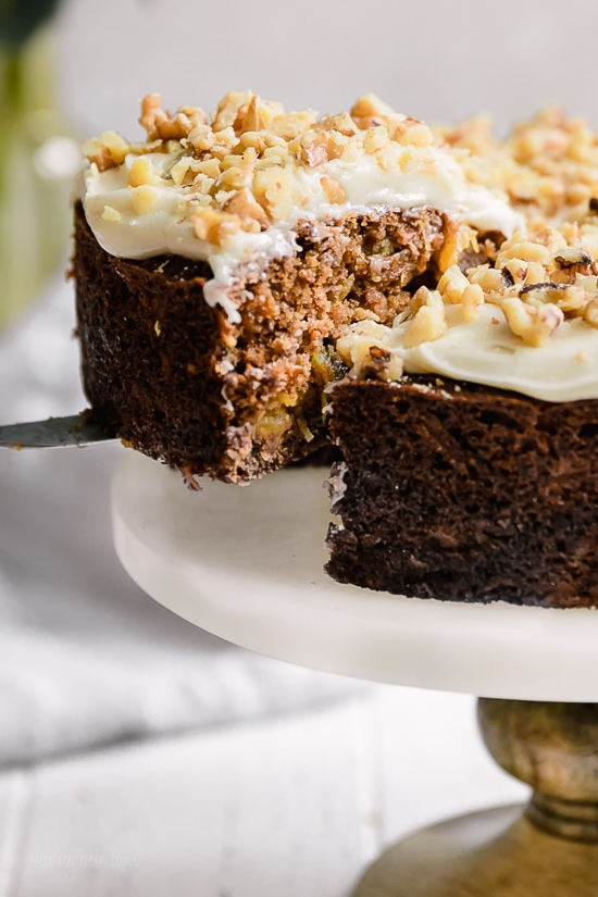 This super moist carrot cake recipe is perfect for Easter or anytime of the year. Made with a can of crushed pineapple which makes it very moist, without adding a ton of fat.