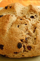 I love to have Irish Soda Bread for breakfast hot out of the oven with some low fat spread and a cup of tea. This is very easy to make, even if you have no experience baking. If you prefer to make a bread to serve with dinner, omit the raisins and sugar and you can add caraway seeds.