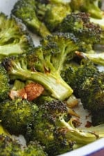 Here's a great way to make broccoli if you are tired of making it the same old way. Roasting broccoli with garlic creates a sweet, nutty delicious flavor and the aroma that wafts through your kitchen will make everyone asking when's dinner ready.