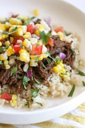 Barbacoa Beef with corn salsa on a plate.