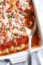 The secret to the best, irresistible manicotti is to make them from scratch with my easy homemade crespelles, which are basically Italian crepes. These spinach and cheese manicotti are filled with three cheeses – ricotta, mozzarella and parmesan, then topped with homemade sauce. So damn delicious!