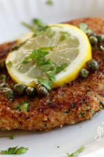 Chicken Piccata is an Italian chicken dish served in a lemon, wine, butter sauce with capers and parsley.