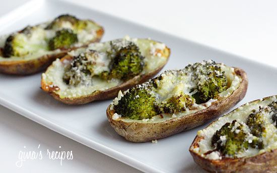 A plate of potato skins filled with broccoli and melted cheese