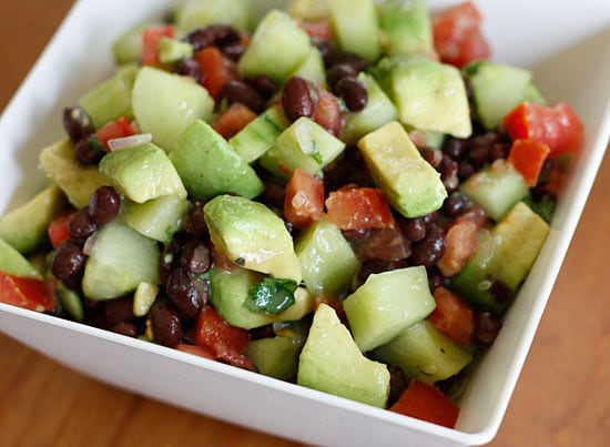 A bowl of black bean, tomato, cucumber, avocado salad
