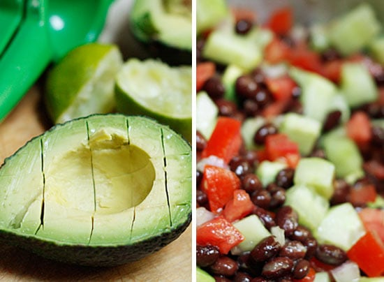 A half avocado with slice marks and a mixture of cubed avocado, diced cucumber, diced tomato, and black beans