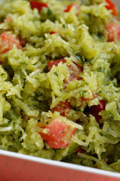"Pesto Spaghetti Squash with Tomatoes – My garden is full of basil and my favorite thing to make with it in the summer is pesto. My husband called this ""squashta"" since I usually make this with pasta."