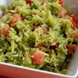 """Pesto Spaghetti Squash with Tomatoes – My garden is full of basil and my favorite thing to make with it in the summer is pesto. My husband called this """"squashta"""" since I usually make this with pasta."""