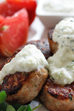 Greek Turkey Meatballs slathered with Tzatziki sauce, great over rice, with chickpea salad or served as an appetizers. Also great for make-ahead meal prep lunch.