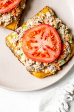 Open Faced Tuna Melt is the ultimate sandwich for all you tuna lovers! Serving them open faced is an easy way to make them healthier and cut the calories.