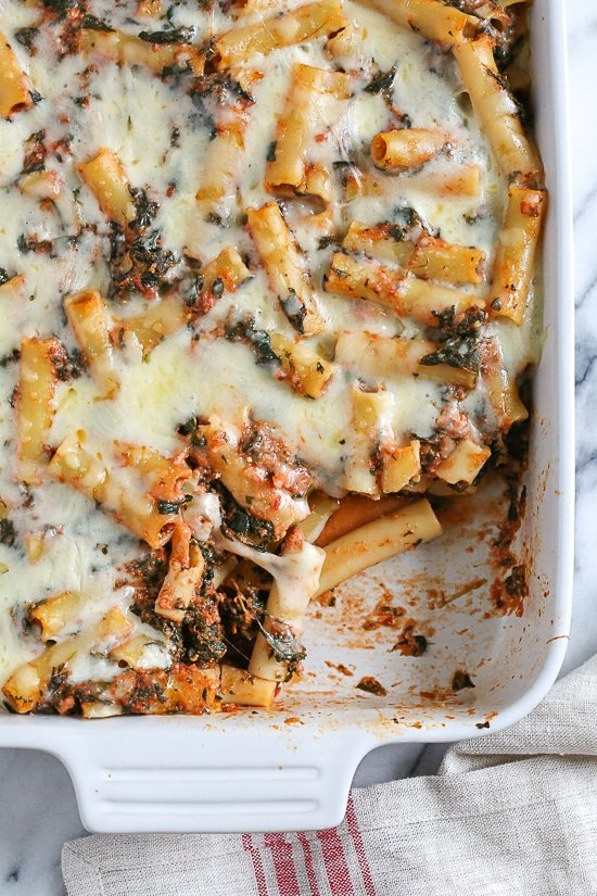 Baked ziti is a favorite comfort dish in my home! Adding spinach is a quick and easy way to get more leafy greens into your family's diet without complaints.