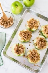 Baked apples topped with oats, cinnamon and a touch of brown sugar. Easy to make and a great way to use up those apples this Fall! They are like little individual apple crisps without all the added fuss of cutting and peeling the apples. A simple, light dessert for a cool autumn evening, serve this a la mode for an extra special treat!