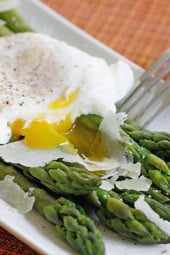 Poached eggs, asparagus, kosher salt, fresh pepper and shaved Pecorino Romano. This simple egg dish is delicious for breakfast, lunch or brunch. You can serve this with whole grain toast on the side.