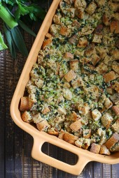 Day old whole wheat French bread, bacon, onion, celery, sage and parsley are combined then baked to make a place at your Thanksgiving table.