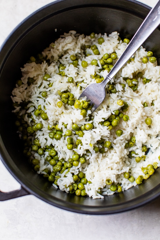 This simple Baked Rice and Peas dish uses pantry and freezer staples, a great side dish to go along with grilled shrimp or chicken.