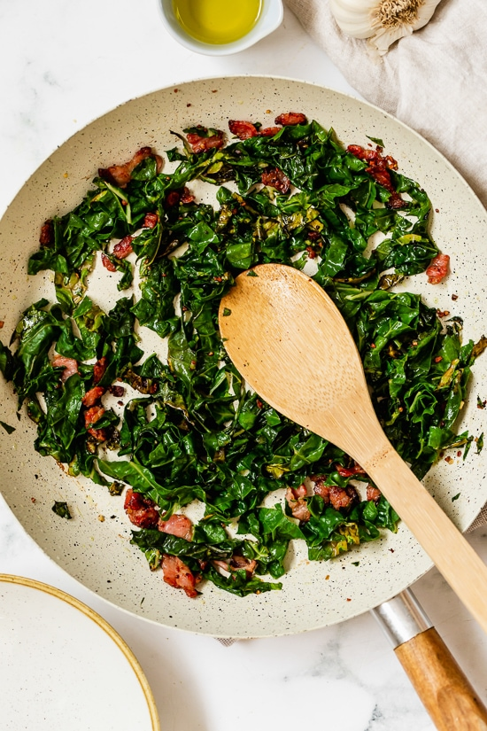 Collard Greens and Bacon in a skillet.