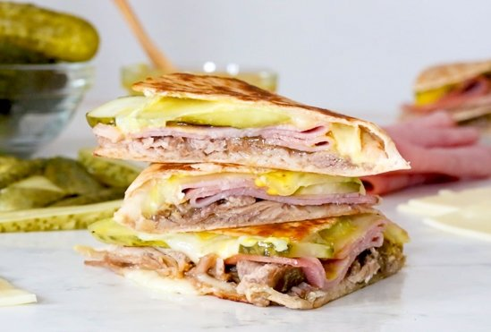 I made my favorite Cuban sandwich into a quesadilla filled with roast pork (pernil), ham, Swiss cheese, pickles, and mustard! Perfect for a quick lunch and a great way to use up my Slow Cooker Pernil.