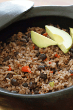 The aroma that fills your kitchen while cooking this Cuban rice and black beans dish, arroz congri, will make you want to pump up the salsa music and grab a mojito!