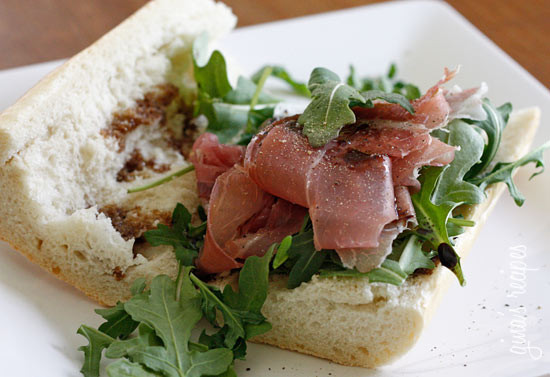 This prosciutto di Parma, peppery arugula, sweet balsamic and heart healthy olive oil on french bread is a winning combination.