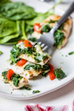 Grilled Chicken with Spinach and Melted Mozzarella on a fork