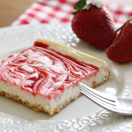 Low fat cheesecake swirled with strawberry jam on graham cracker crust.
