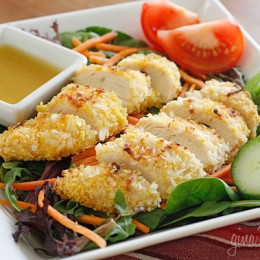 Warm oven-fried coconut chicken over a bed of baby greens, cucumber, tomato, shredded carrots topped with a hot honey mustard vinaigrette. It's the perfect mix of salty and sweet, warm and cold.