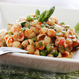 A light Spring pasta dish the whole family will enjoy; baby shells are tossed with chopped asparagus and a light marinara sauce. Quick and easy, perfect for vegetarians or meatless Fridays.