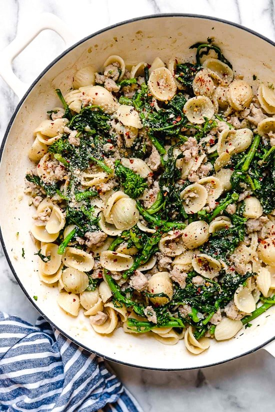 Orecchiette Pasta with Sausage and Broccoli Rabe uses chicken sausage in place of pork and a whole lot of garlic! This lightened up version will not disappoint!!